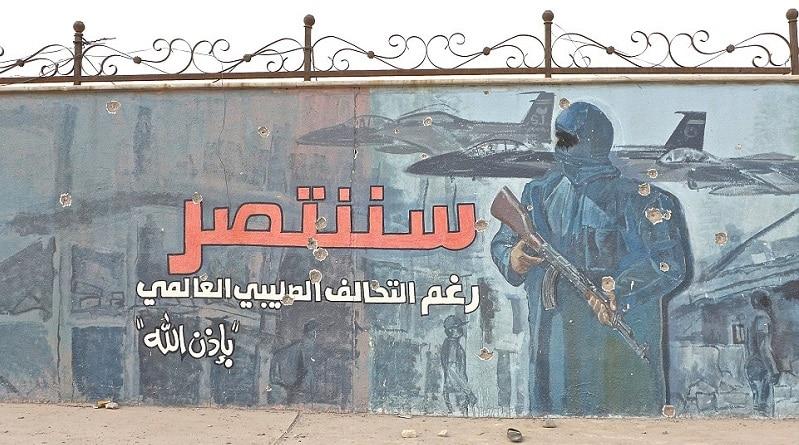 Murale dell'ISIS mural, Mosul est. Osie Greenway/SIPA USA/PA Images. Tutti i diritti riservati.