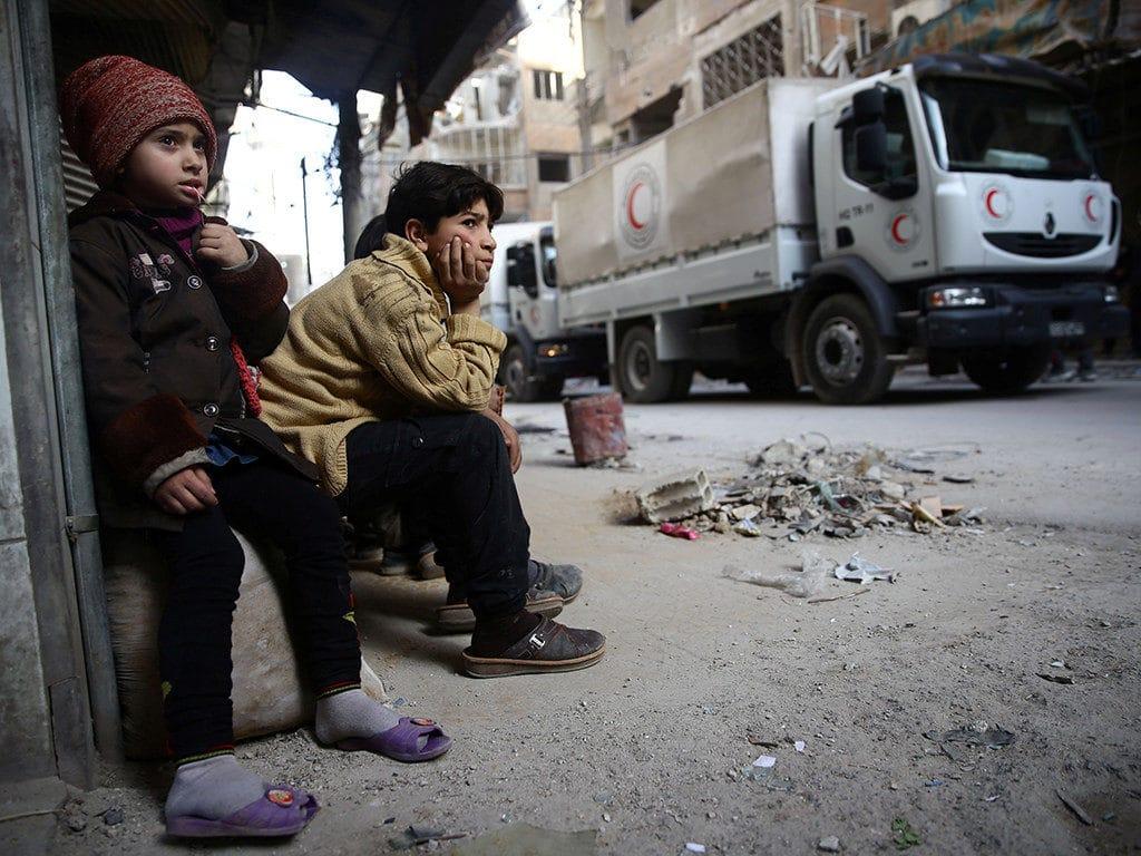 Bambini nella città assediata di Douma - Foto Flickr Creative Commons - Jordi Bernabeu Farrus
